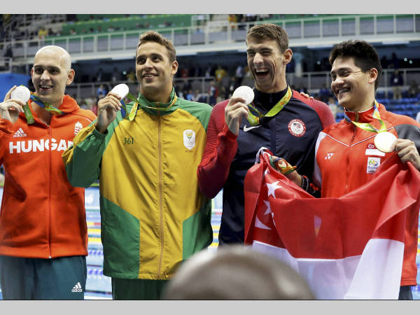 From left: Silver medal winners Laszlo Cseh, Chad Le Clos, Michael Phelps and gold medallist Joseph Schooling after the 100m butterfly event at Rio Olympics