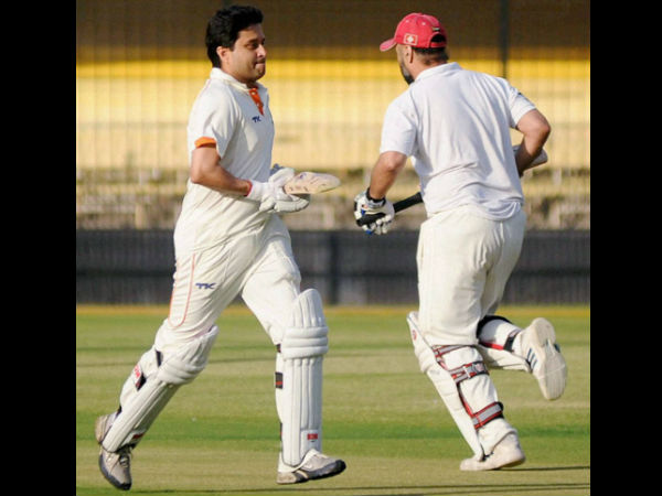 MPCA Chairman, Congress MP Jyotiraditya Scindia tries to steal a run during a cricket match at Holkar Cricket Stadium in Indore