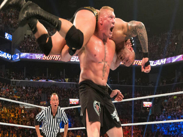 Brock Lesnar (standing) fighting against Randy Orton (Image courtesy: wwe.com)