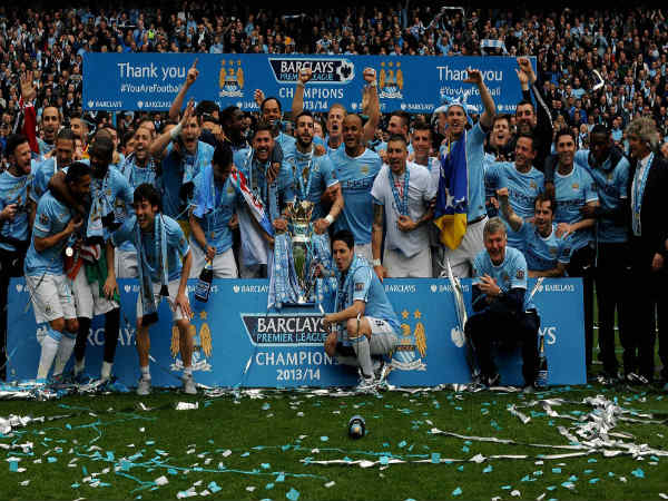 Manchester City's players celebrate after being crowned Champions in 2013/14 season