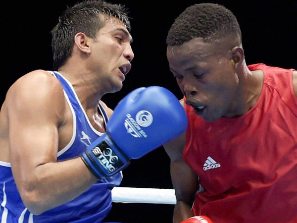 Manoj Kumar (left) in action against Lesotho's Moshoeshoe M Les during the Men's Light Welter 64kg boxing round match of the Commonwealth Games in Glasgow