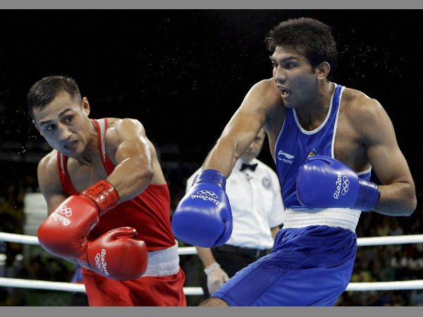 Uzbekistan's Fazliddin Gaibnazarov, left, andIndia's Manoj Kumar exchange punches during a men's lightwelter weight 64-kg preliminary boxing match at the 2016 Summer Olympics in Rio de Janeiro, Brazil, Sunday, Aug. 14, 2016.