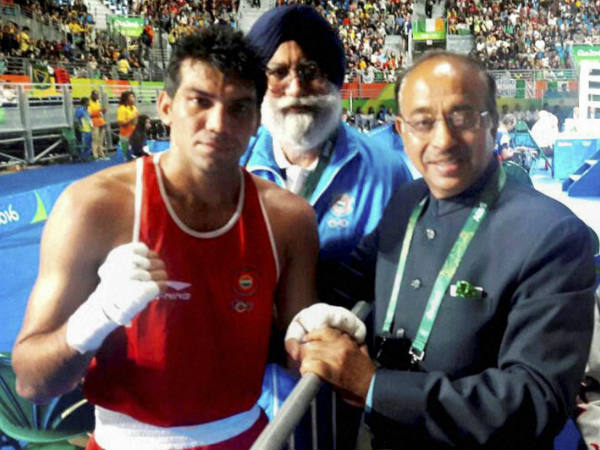 Vijay Goel (right) greeting Indian boxer Manoj Kumar (64 kg category) after he defeated Petrauskas E. of Lithuania, at Rio Olympics on Wednesday (August 11). Boxing Coach Shri G.S. Sandhu is also seen.