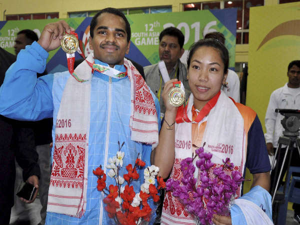 Saikhom Mirabai Chanu (right) after winning gold medal in 38kg weightlifting category at South Asian Games