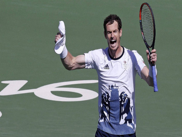 Andy Murray, of England, raises his arms after defeating Kei Nishikori, of Japan