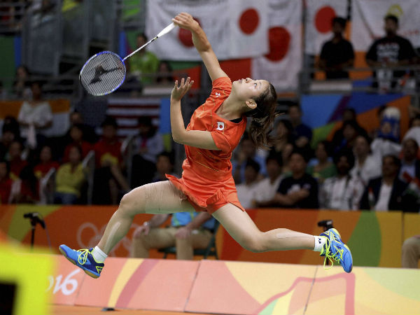 Japan's Nozomi Okuhara plays against India's Sindhu Pusarla during a women's singles semifinal badminton match at the 2016 Summer Olympics in Rio de Janeiro.