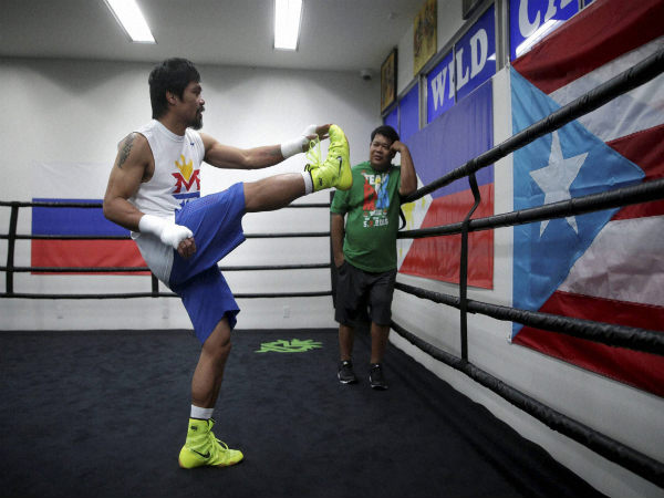 Manny Pacquiao, of the Philippines, gets ready for his boxing workout