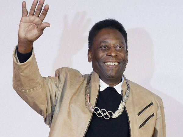 Pele waves during a ceremony at which he was awarded the Olympic Order at the Pele Museum