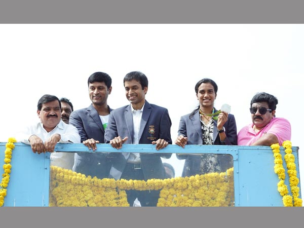 Celebrations: PV Sindhu (second right), coach Pullela Gopichand (3rd right) on top of a double-decker bus with others in Hyderabad