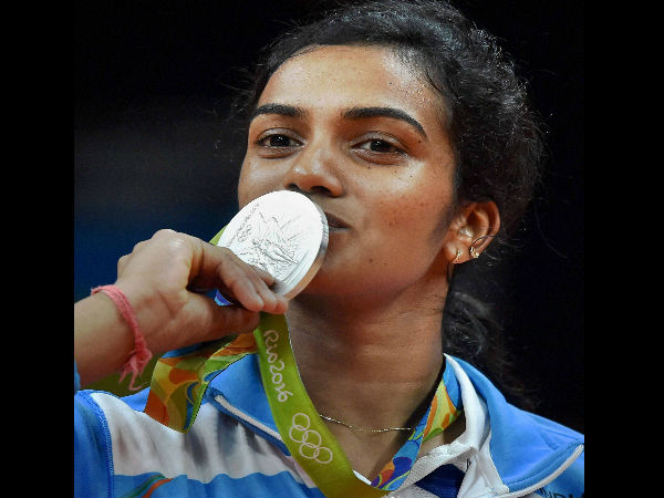 India's Pusarla V Sindhu kisses her silver medal after her match with Spain's Carolina Marin in women's Singles final at the 2016 Summer Olympics at Rio de Janeiro in Brazil