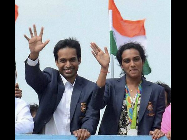 File photo: PV Sindhu (right) along with her coach Pullela Gopichand at Hyderabad