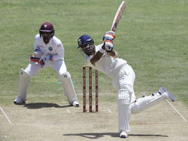 KL Rahul hits a six off Devendra Bishoo (not pictured) during his 158-run knock