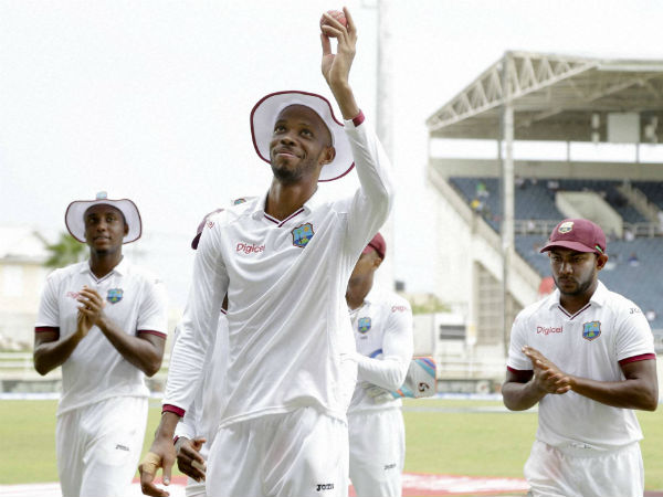 Roston Chase holds the ball up after taking 5 wickets against India in the 2nd Test