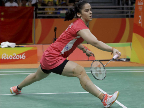 India's Saina Nehwal returns a shot to Ukrain's Maria Ulitina during a Women single match at the 2016 Summer Olympics in Rio de Janeiro, Brazil, Sunday, Aug. 14, 2016.
