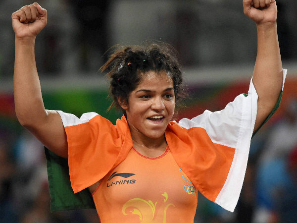 Sakshi Malik celebrates after she beat Kyrgyzstan's Aisuluu Tynybekova to win the bronze