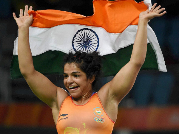 Sakshi Malik celebrates after winning bronze medal of the women's wrestling freestyle 58-kg competition, at the Rio Olympics 2016