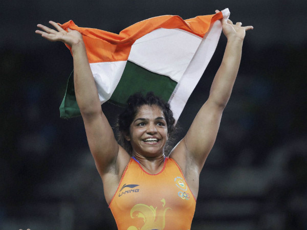 Sakshi Malik celebrates with the tri-colour after claiming bronze medal at Rio Olympics