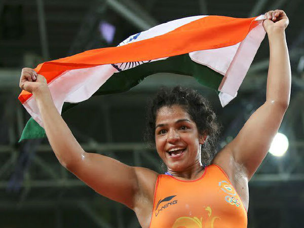 Sakshi Malik celebrates with the Indian national flag after winning bronze medal at Rio Olympics 2016