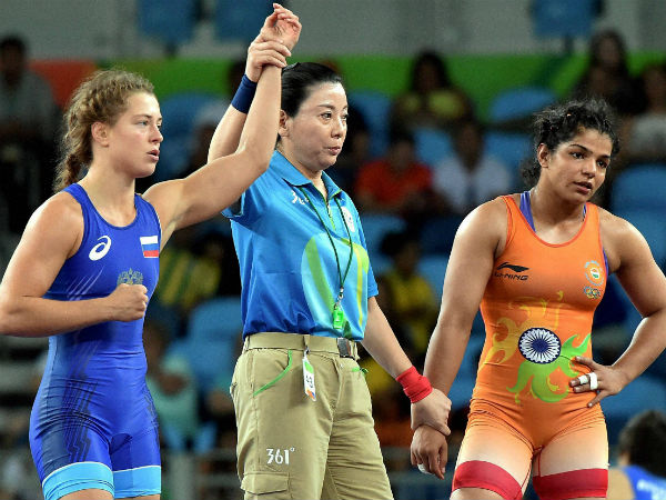 Russian wrestler Valeria Koblova celebrates after winning against India's Sakshi Malik during the quarterfinal match of Women's freestyle 58 kg at Summer Olympics 2016 at Rio de Janeiro in Brazil on Wednesday.