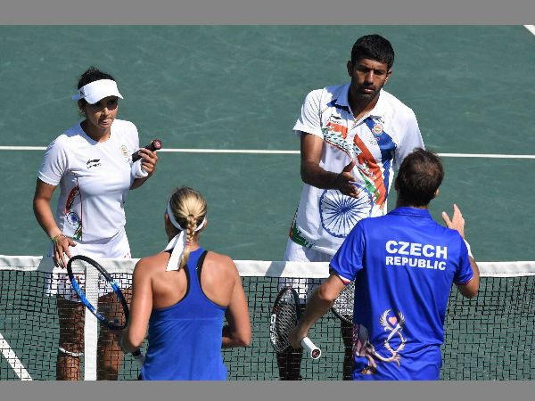 India's Sania Mirza and Rohan Bopanna during their mixed-doubles semifinal match after they lost to Czech Republic's Lucie Hradecka and Radek Stepanek. 1-6, 5-7.