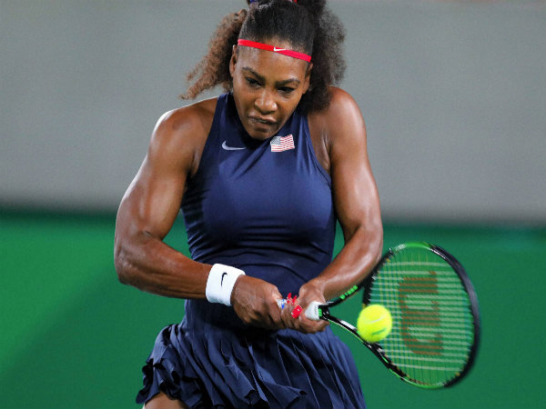 Serena Williams of the United States returns to France's Alize Cornet in the women's tennis competition at the Rio Olympics 2016