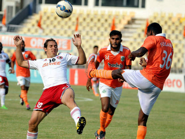 Sporting clube de Goa (orange) and Shilong Lajong players in action during their I league match