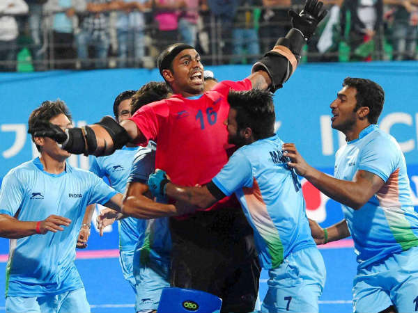 File photo: Sreejesh (red) celebrates with team-mates during a match