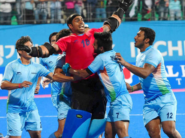 Indian hockey goalkeeper Sreejesh celebrate with team mates after beating Pakistan during the men's hockey final at 17th Asian Games