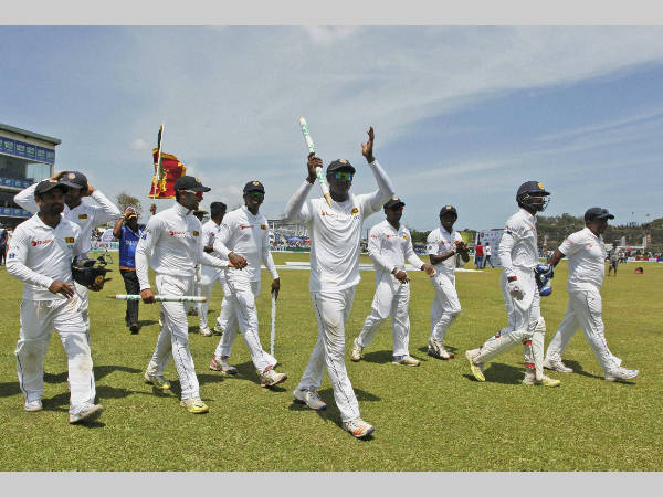 Sri Lanka players celebrate their victory in the 2nd Test