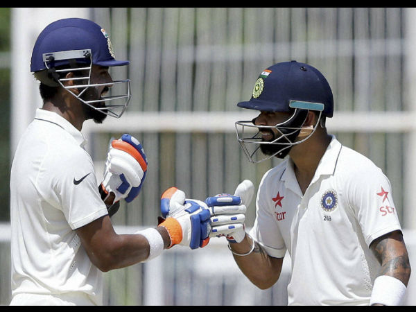 Virat Kohli, right, greets teammate India's Lokesh Rahul during day two of their second cricket Test match against West Indies at the Sabina Park Cricket Ground in Kingston, Jamaica, Sunday, July 31, 2016.