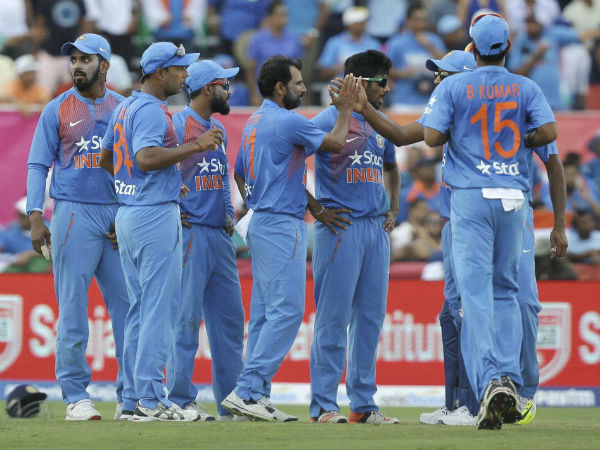 India's Mohammed Shami, center, is congratulated after taking the wicket of West Indies' Johnson Charles during the first Twenty20 international cricket match, Saturday, Aug. 27, 2016, in Lauderhill
