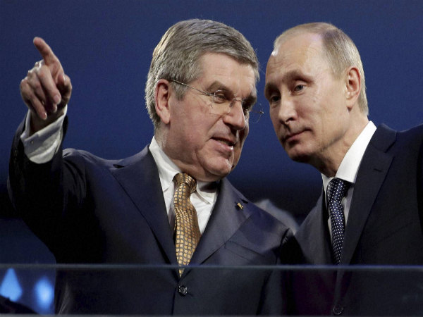 International Olympic Committee President Thomas Bach (left) and Russian President Vladimir Putin watch the closing ceremony of the 2014 Winter Olympics in Russia