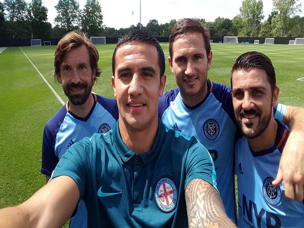 Tim Cahill (front) poses with Andrea Pirlo (left), Frank Lampard (centre) and David Villa (right)