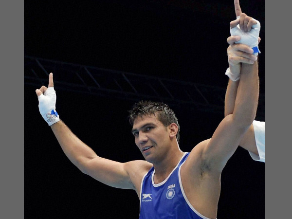 Manoj Kumar being declared winner in a match against Lesotho's Moshoeshoe M Les during the Men's Light Welter 64kg boxing round match of the Commonwealth Games