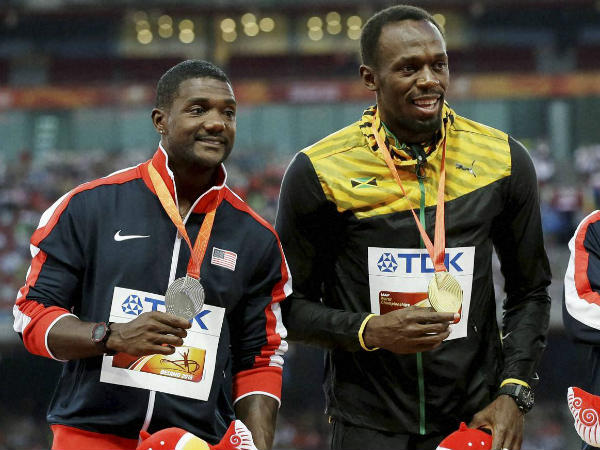 File photo: Gatlin (left) and Bolt at the 2015 World Championships in Beijing. Bolt won gold and Gatlin took silver last year