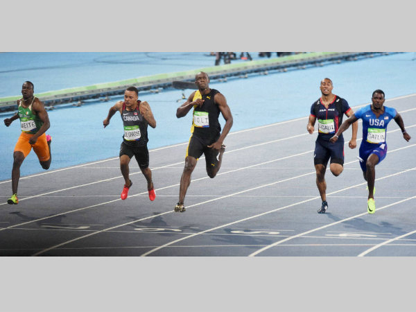 Usain Bolt (centre) wins the 100m race at Rio Olympics
