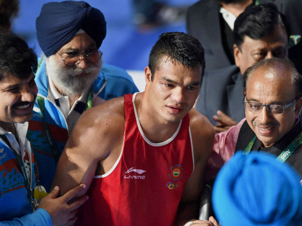 Indian boxer Vikash Krishan (in red) is congratulated by Union sports minister Vijay Goyal (right) after defeating Charles Albert Shone Conwell of USA in Rio Olympics on Tuesday (August 9).