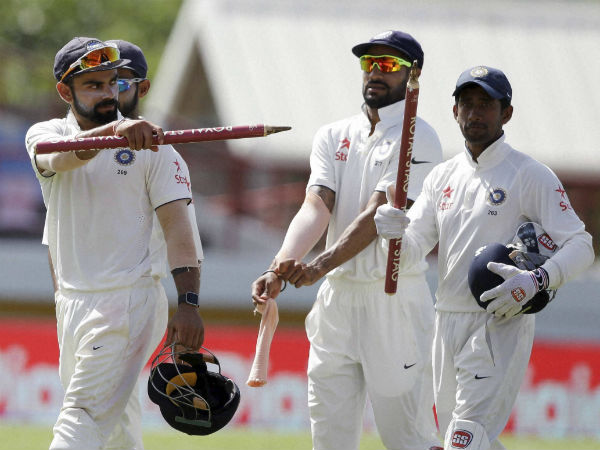 Virat Kohli (left) and his team-mates celebrate after winning the 3rd Test against West Indies