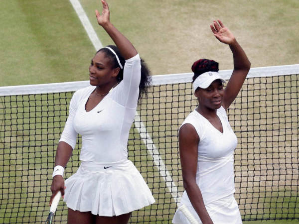 Serena Williams (left) and Venus Williams celebrate after winning a match