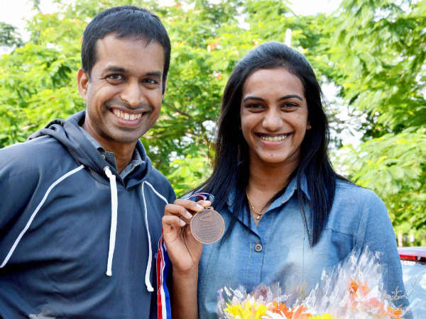 Pullela Gopichand (left) with P.V. Sindhu
