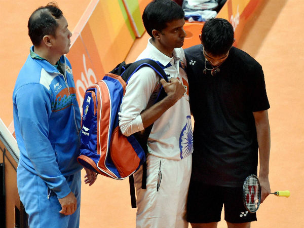 India's Srikanth Kidambi with coach P Gopichand after losing to Lin Dan of China the quarterfinal match of Men's Singles Badminton at 2016 Summer Olympics at Rio de Janerio in Brazil on Wednesday.