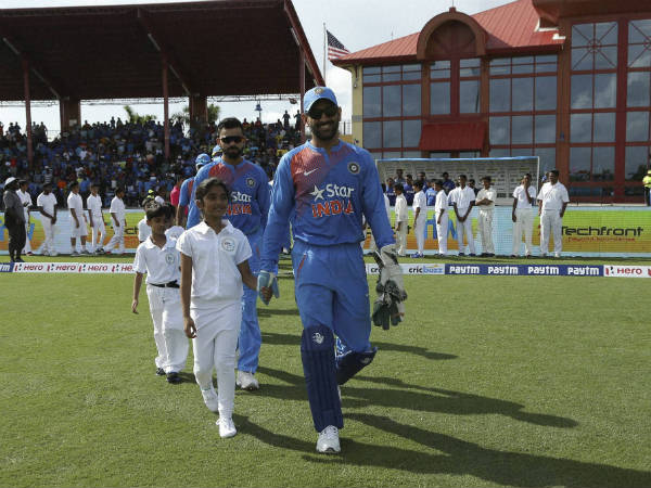 MS Dhoni (front, right) leads the Indian team onto the field in 1st T20I, to set a record