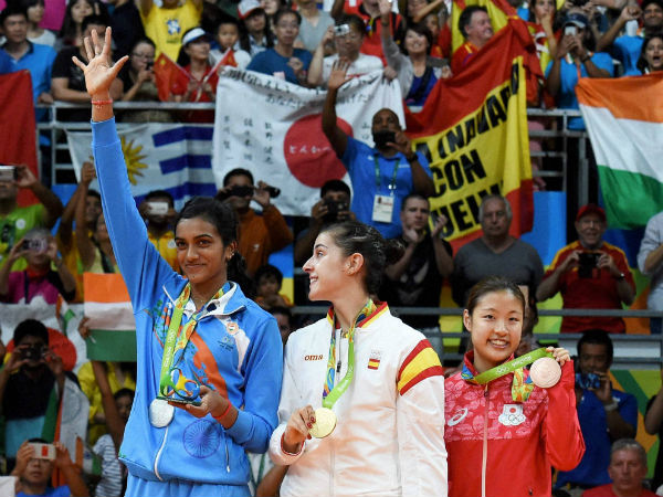L-R) Silver medalist V. Sindhu Pusarla of India, gold medalist Carolina Marin of Spain and bronze medalist Nozomi Okuhara of Japan celebrate during the medal ceremony after the Women's Singles Badminton Final.