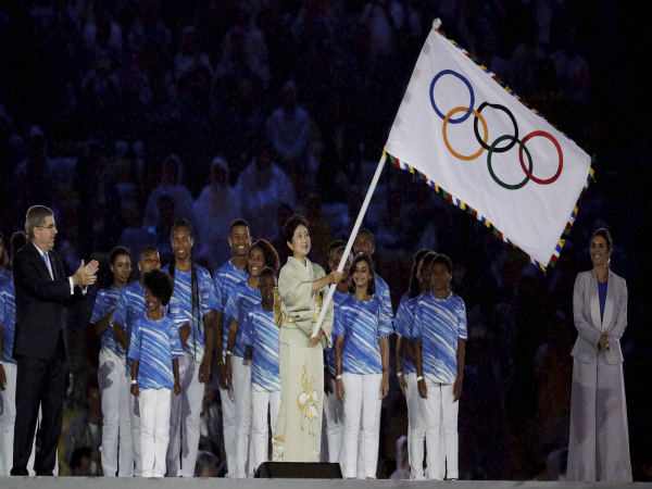 Tokyo Governor Yuriko Koike waves the Olympic flag as IOC President Thomas Bach stands at left during the closing ceremony at Rio Olympics 2016
