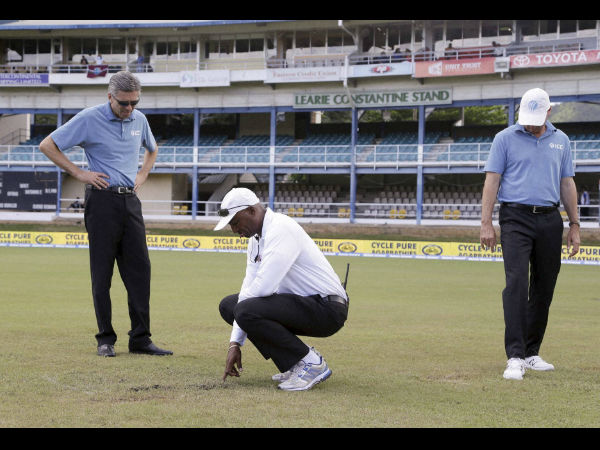 Umpire's inspecting Queen's Park Oval outfield during 4th Test match between India and WI