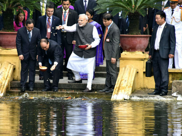 PM Modi feed fish in Uncle Ho's pond in Hanoi