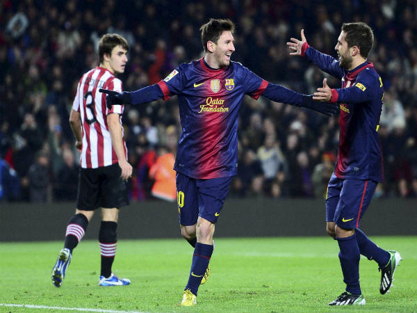 Jordi Alba (right) celebrates with Lionel Messi
