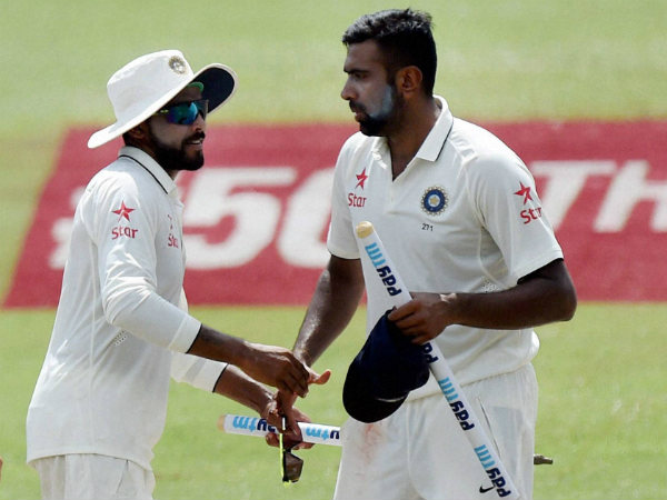 Jadeja (left) and Ashwin are photographed after the 1st Test win in Kanpur