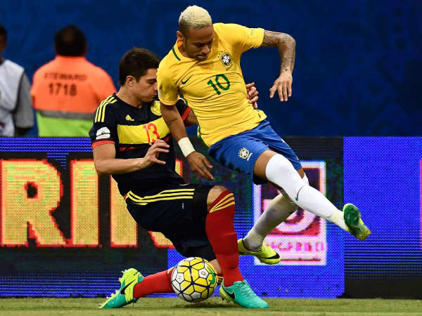 Neymar (right) tackled by Colombian defender (Image courtesy: FIFA World Cup Twitter handle)