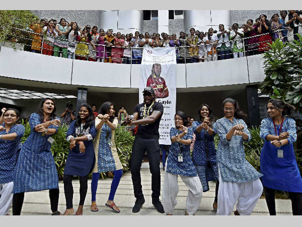 Chris Gayle dances with students during a function at a private college in Chennai on Wednesday (September 7).